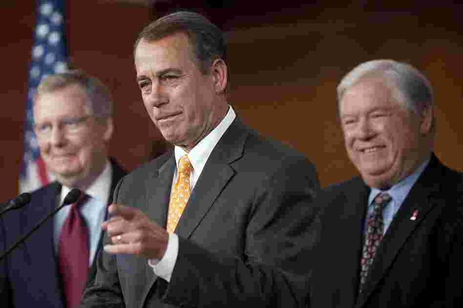 House Republican Leader John Boehner, R-OH (center), speaks during a press conference with Senate Republican Leader Mitch McConnell (left) and Mississippi Governor Haley Barbour (right) on Capitol Hill.