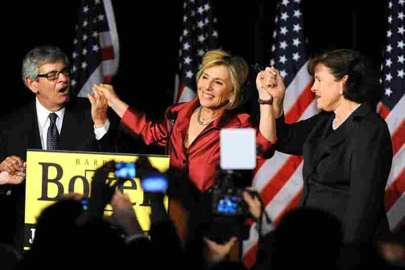 Sen. Barbara Boxer, D-CA, (center) celebrates with her husband and Sen. Dianne Feinstein after winning a fourth term in a close race against Republican candidate Carly Fiorina.