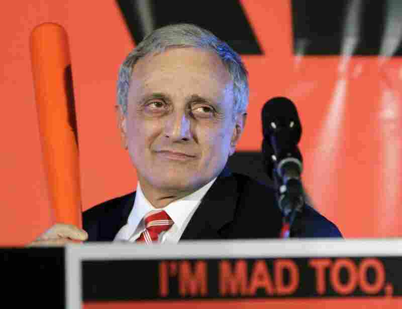 New York Republican Carl Paladino holds a baseball bat in Buffalo as he concedes the gubernatorial election to Democrat Andrew Cuomo.