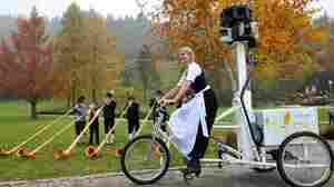 Bianca Keybach rides a trike equipped with Google Street View cameras in a park in Oberstaufen in Ba