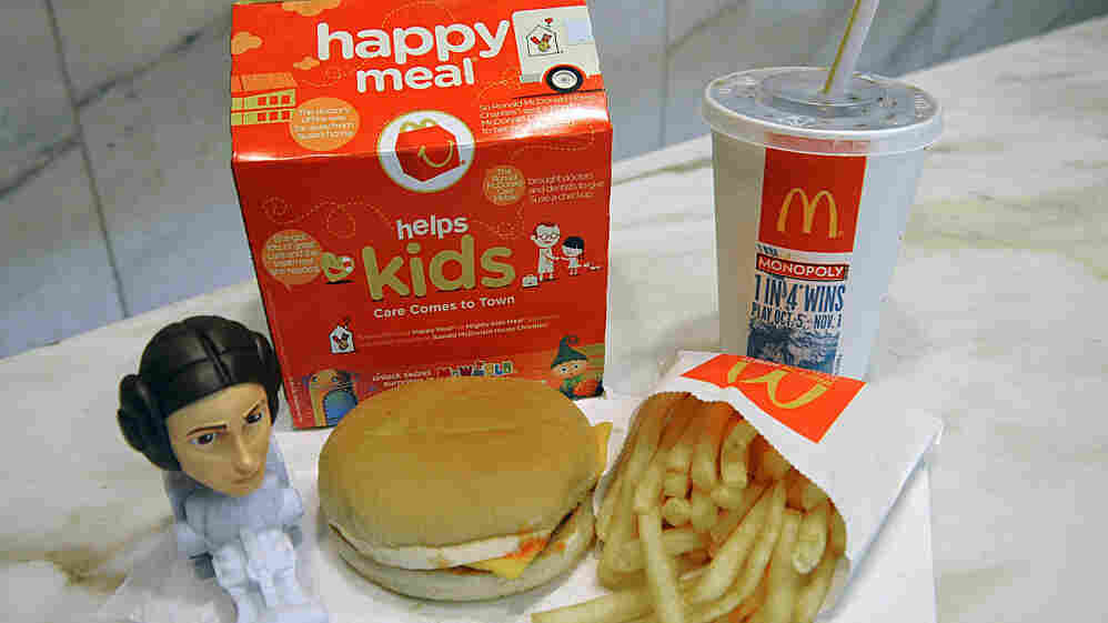 A McDonald's Happy Meal with a Star Wars figure.