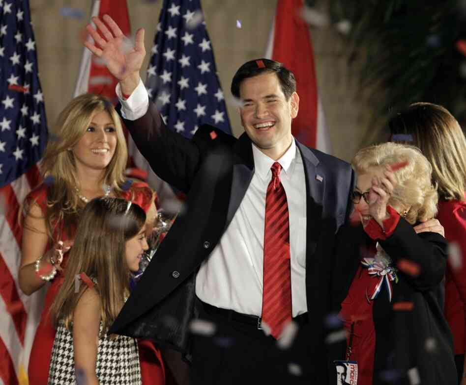 Republican Marco Rubio will be Florida's next senator after he thumped Democrat Kendrick Meek and Gov. Charlie Crist, the Republican-turned-independent. Here, Rubio and his mother, Oria,  wave to the crowd in Coral Gables, Fla., with his wife, Jeanette, and daughter Amanda.