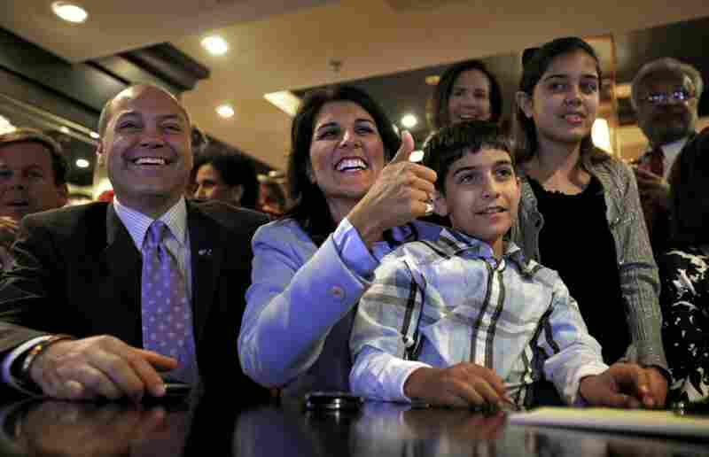 Nikki Haley became South Carolina's first female governor after beating Democrat Vincent Sheheen. Here, she watches election results in Columbia, S.C., with her husband, Michael, son Nalin and daughter Rena.