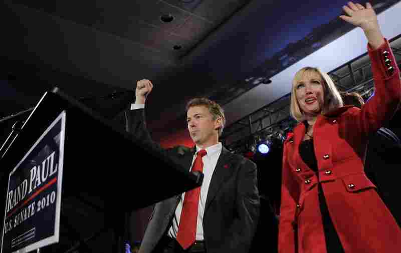 Political newcomer and Tea Party champion Rand Paul won the Kentucky Senate seat over the state's Democratic attorney general, Jack Conway. Here, Paul and his wife, Kelley, take the stage at a victory celebration in Bowling Green on Tuesday night.