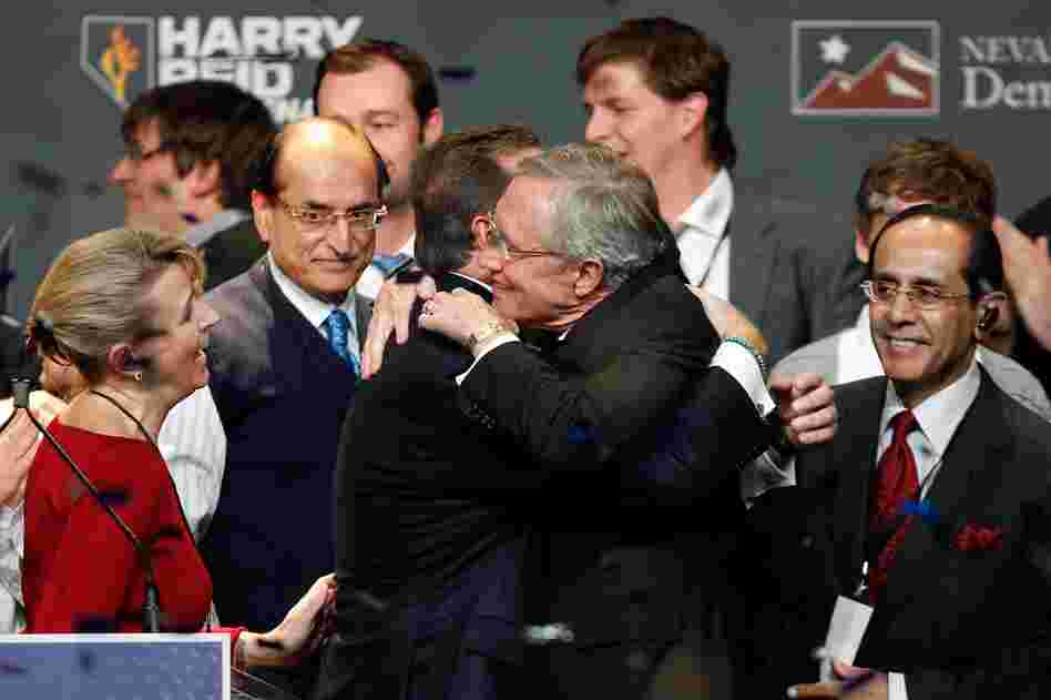 Senate Majority Leader Harry Reid embraces family members after defeating Sharron Angle in Nevada. Reid's victory helped Democrats hold their Senate majority.