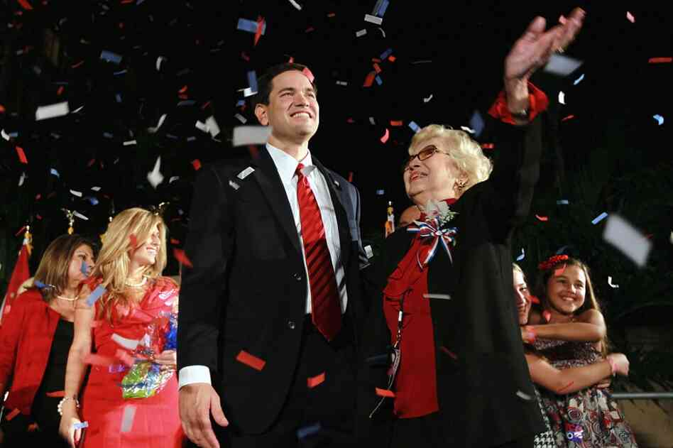 "Republican Marco Rubio stands with his mother, Oria Rubio, during his ""Reclaim America Victory Celebration"" in Coral Gables, Fla., after he clinched the Florida Senate seat."