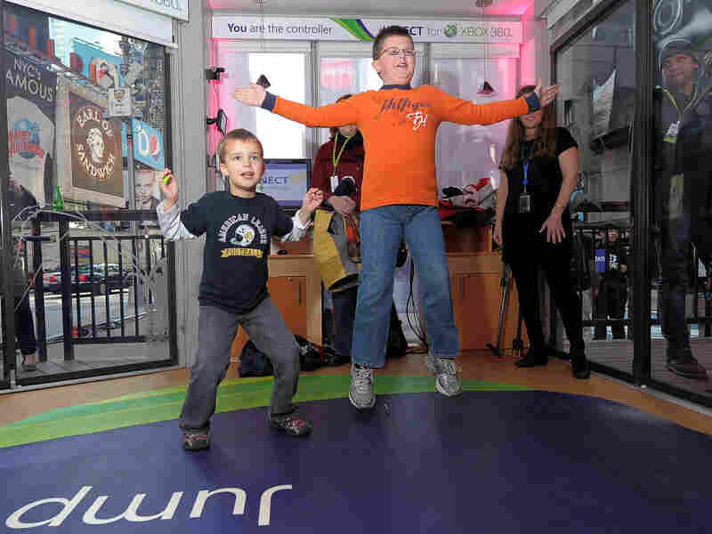 Kids play with the Kinect for Xbox 360 during a launch event in New York City.