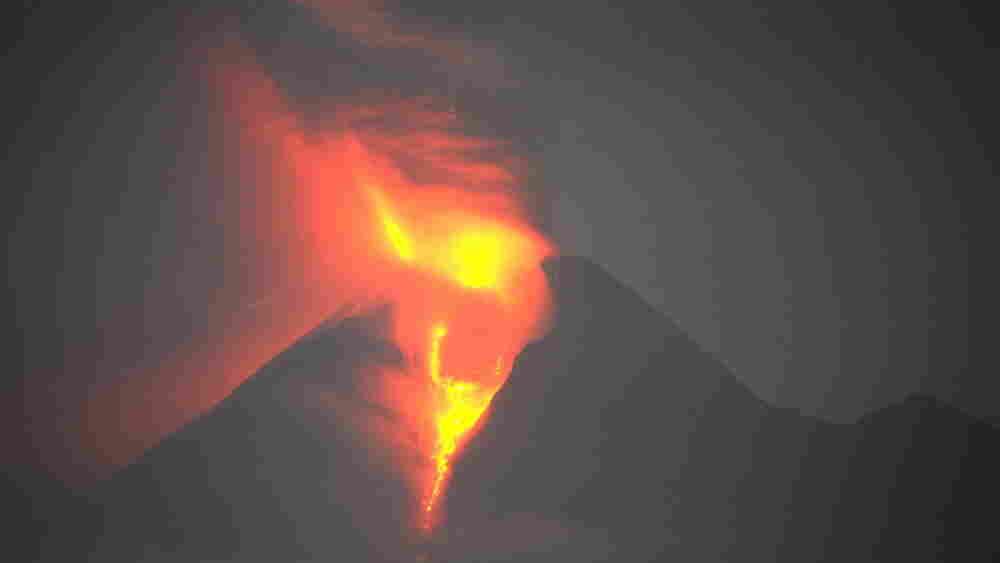 Massive molten lava and searing ash clou