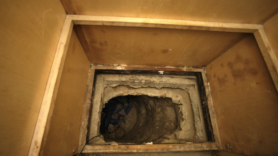 The opening of a 600-yard tunnel found in a warehouse along the border between the United States and Mexico. Authorities discovered 30 tons of marijuana were smuggled using this passageway.