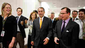 Republican Leader John Boehner is surrounde by reporters.