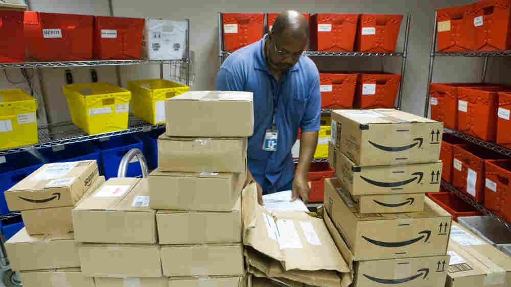 Nathaniel Horton sorts through books in NPR's mailroom.