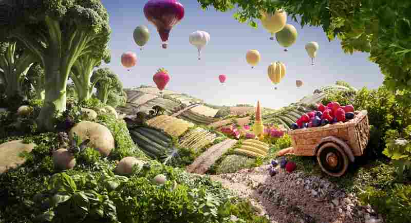 Cart & Balloons: Balloons: red onion, apple, strawberry, garlic bulb, other fruits. Balloon baskets: nuts. Hills and fields: bread, cucumbers, string beans, green beans, corn, asparagus, cabbage leaves.