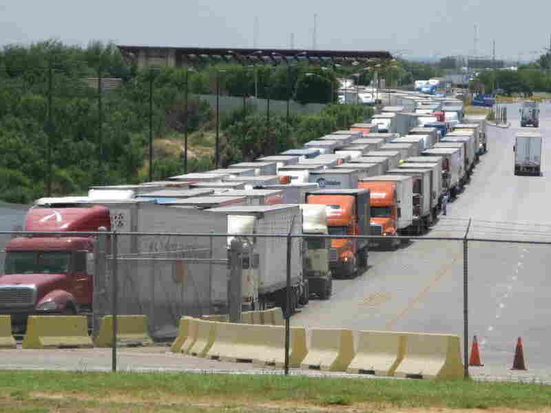 Trucks lined up on the World Trade Bridge