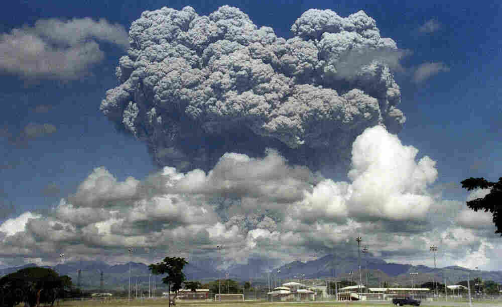 The eruption of Mt. Pinatubo in the Philippines in 1991 spewed almost 20 million tons of sulfur dioxide into the atmosphere, causing worldwide temperatures to drop half a degree on average. Now, scientists are considering mimicking the effect, but there's debate over whether it should be done and who should regulate it.