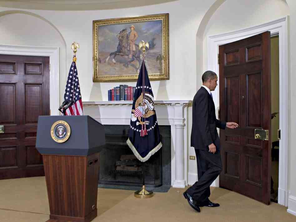 Obama leaving Roosevelt Room