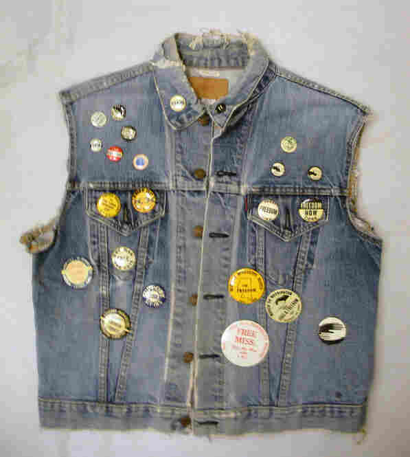 "Denim Vest With SNCC ButtonsMulholland joined SNCC in 1960 and served as an office assistant in Mississippi for several years. A button that reads ""Never"" on the collar of her vest is Bunch's favorite. ""That was what segregationists would wear to counter that, to say that you never integrate,"" Bunch explains. ""But what the SNCC people did is they took that button and turned it upside dow..."