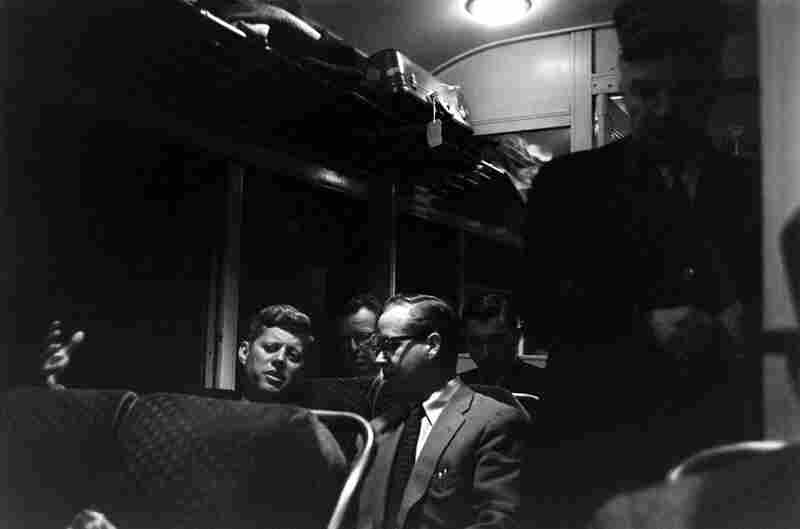 In late 1959, well before receiving the Democratic Party's nomination for president, Kennedy, the junior senator from Massachusetts, chats with Ted Sorensen on a train in Wisconsin. Sorensen, who died recently, became famous as JFK's primary speechwriter.