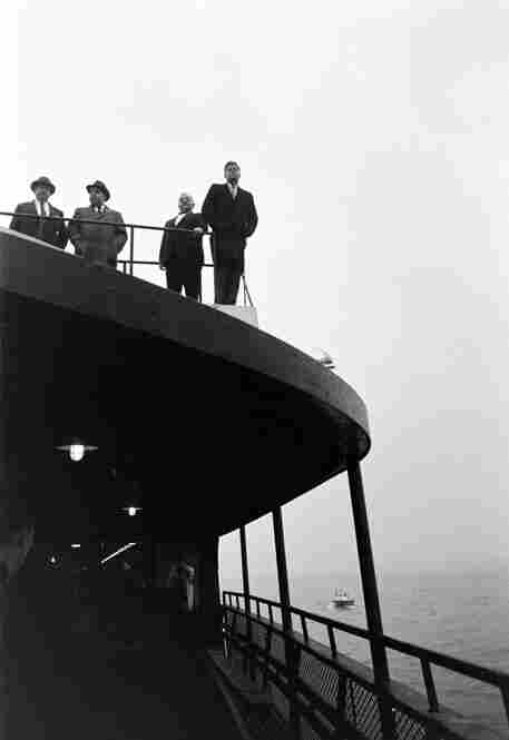 Even when alone, campaigning candidates never enjoy true solitude. Here, surrounded by people, JFK stares out at the New York Harbor in October 1960. Kennedy defeated Nixon by a scant 113,000 votes out of more than 68 million ballots cast.
