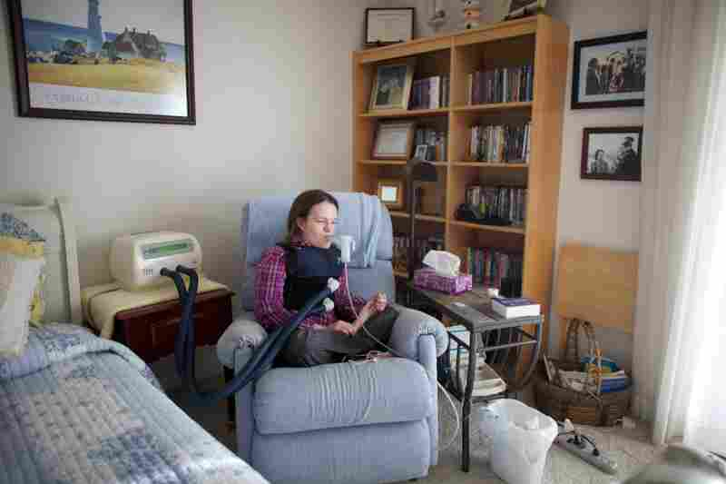 """On the wall of her apartment are pictures of Beckett as a child with President Reagan. Reagan created the """"Katie Beckett waiver"""" that changed the Medicaid rules to allow severely disabled children and adults to get government-funded care in their own homes."""