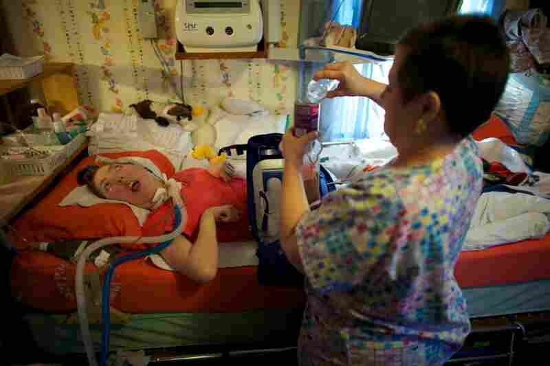 Olivia Welter turns 21 on Nov.9. On her birthday, she will no longer be eligible for the program for disabled children that has kept her healthy. She will lose state funds that cover the expense of nurses like Helen Houchins who prepares liquid food that is sent directly into Welter's stomach through a feeding tube.