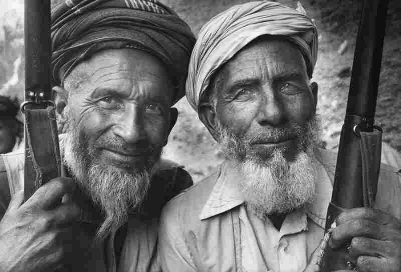 Two Mojahedin fighters, Afghanistan, circa 1990. By the end of the 80s, Gobachev withdrew Russia from Afghanistan, and extreme Taliban fighters had taken tighter control of Afghanistan law.