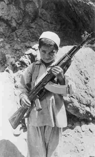 Exactly 100 years later, Russian paratroopers landed in Kabul again, the country already in civil war. Afghanistan's prime minister tried to usher in a more westernized policy, and was met by a strong traditional opposition, and a guerrilla force called Mojahedin, a holy mission for Allah. Here, an Afghan child joins the guerrilla movement, 1980.