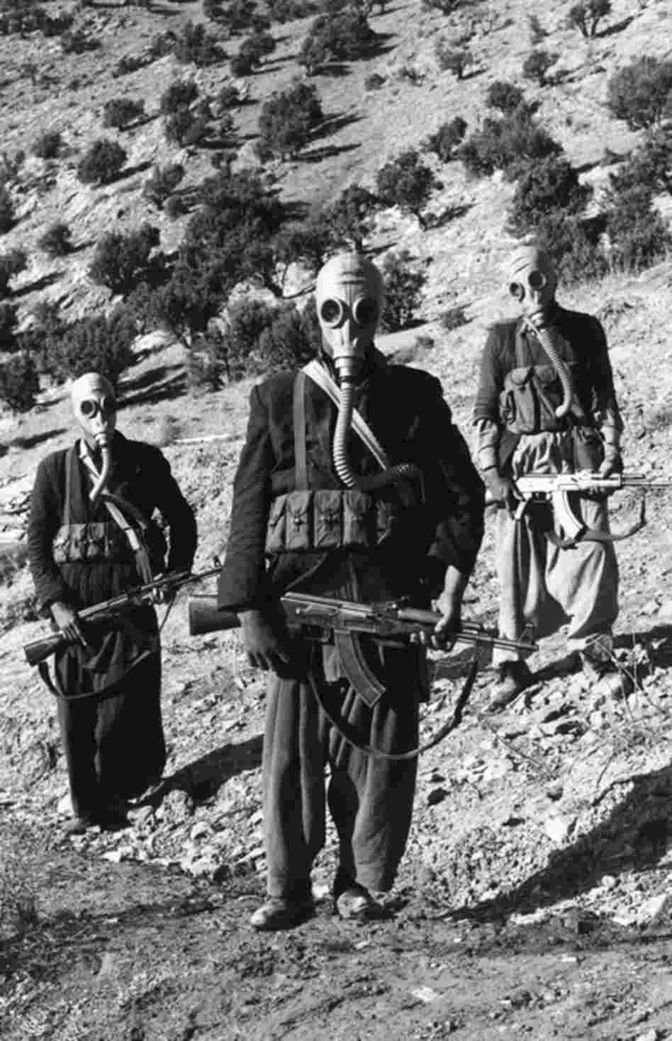 Members of the Mojahedin, rebel Muslim tribe, wearing Russian breathing apparatus for use in chemical warfare, Afghanistan, 1981. Russia claimed that it had been invited by the government for support.