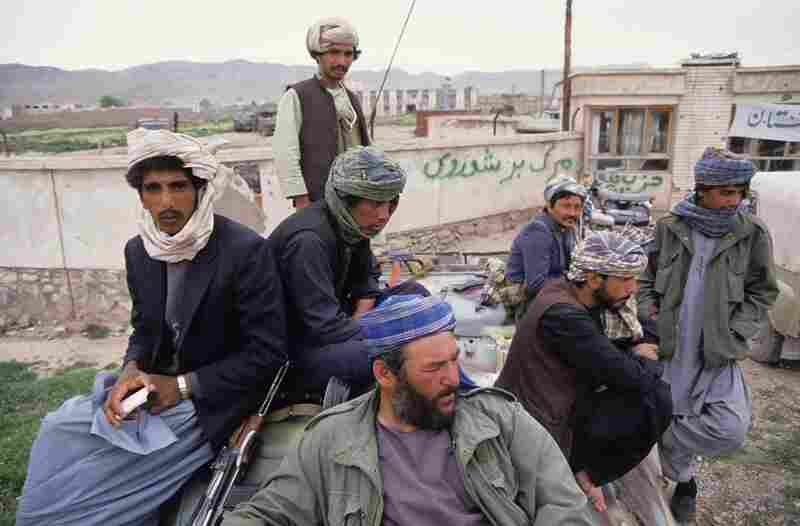 After wresting control of the city of Herat from the Soviet-backed communist regime, Mojahedin fighters, armed with AK-47 automatic assault rifles and wearing typical Afghan turbans, sit on top of a Soviet-made armoured personnel carrier in western Afghanistan, 1992.