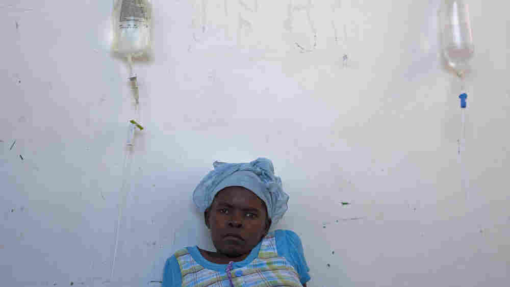 A woman suffering from cholera symptoms is treated at the St. Nicholas hospital in Saint Marc, Haiti
