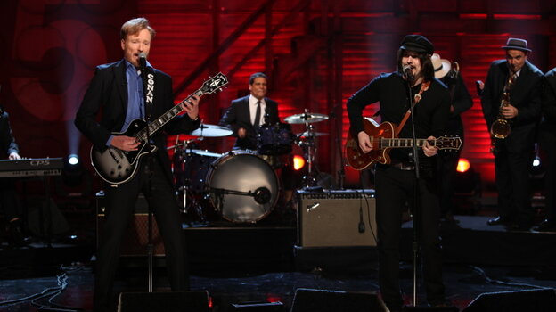 Conan O'Brien plays guitar with Jack White