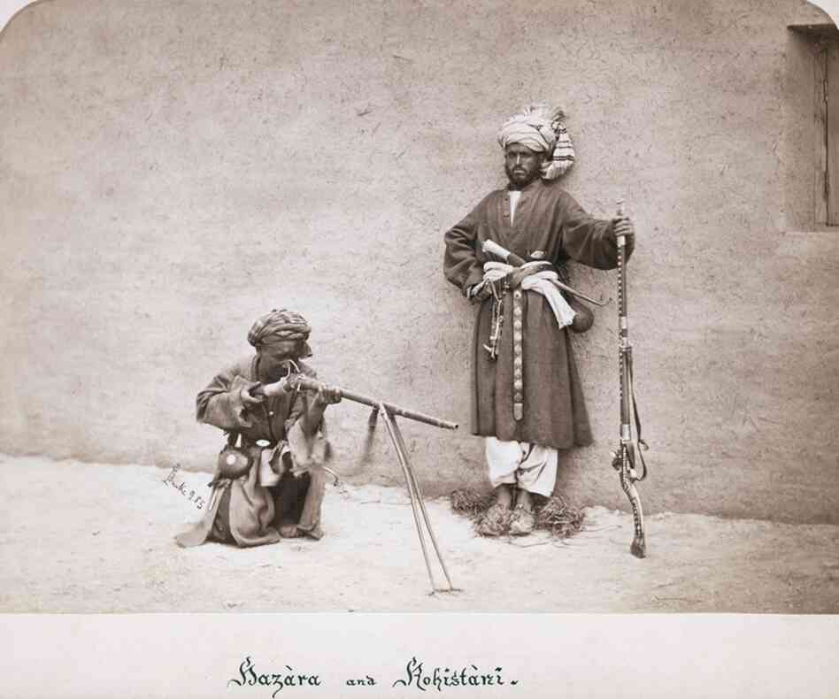Two armed Afghan tribesmen in traditional clothing during the Second Afghan War, circa 1880.