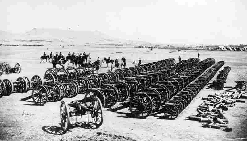A British military commander and his men, inspecting captured guns after the defeat of Ayub Khan at Kandahar, which put an end to the Second Afghan War.