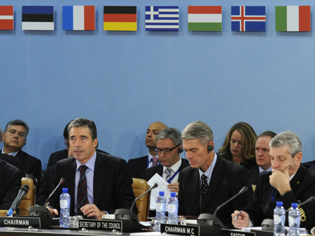NATO Secretary-General Anders Fogh Rasmussen (left) opens a meeting of defense and foreign ministers at NATO headquarters in Brussels on Oct. 14. The ministers discussed the alliance's new Strategic Concept — a mission statement on how the alliance must respond to modern threats.