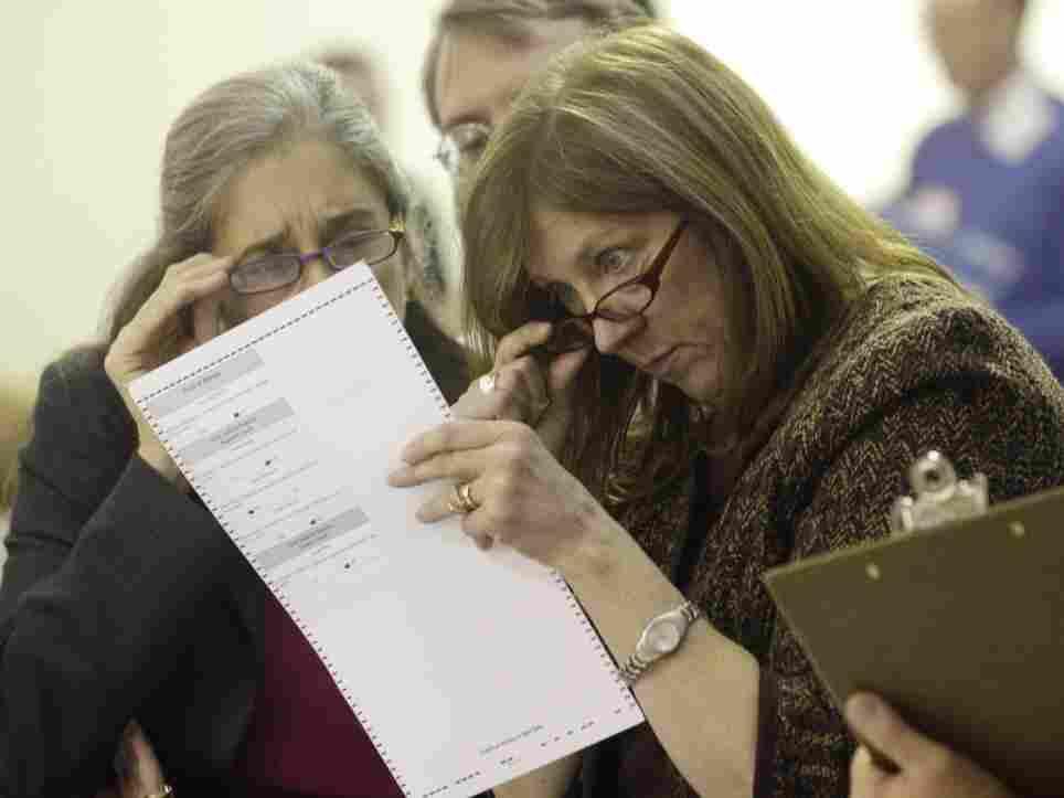 Alaska election officials inspect ballot