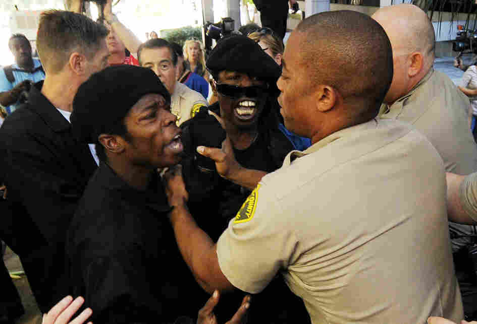 Sheriff's deputies scuffle with members of the Black Riders Liberation Front