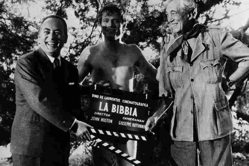 De Laurentiis (from left), actor Michael Parks and director John Huston prepare to shoot the Garden of Eden scene for the epic La Bibbia (The Bible: In the Beginning) in Italy.