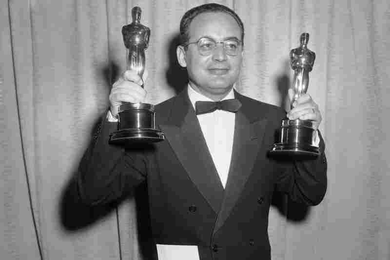 Dino De Laurentiis, 91, died Wednesday, at his home in Beverly Hills, Calif. He was head of a film empire and a two-time Academy Award winner with a string of successful films. Above, De Laurentiis holds the Oscars awarded to him and Carlo Ponti in 1957 for the best foreign language film, La Strada, at the Academy Awards.