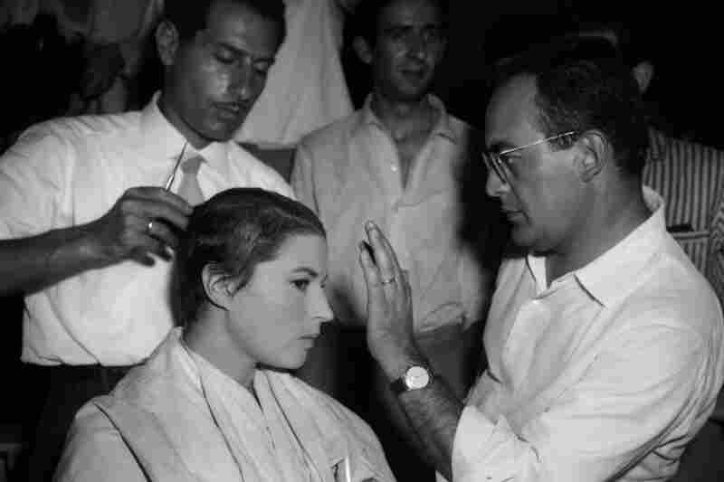 Italian actress Silvana Mangano has her long hair cut off as De Laurentiis, her husband, gives instructions to the hairstylist, Rome, July 22, 1959. Mangano sacrificed her hair for her lead role in De Laurentiis' movie Jovanka.
