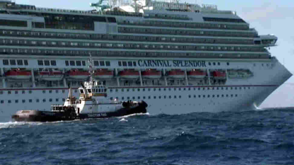 In this image taken from video, tugboats pull the disabled ship Carnival Splendor toward San Diego.