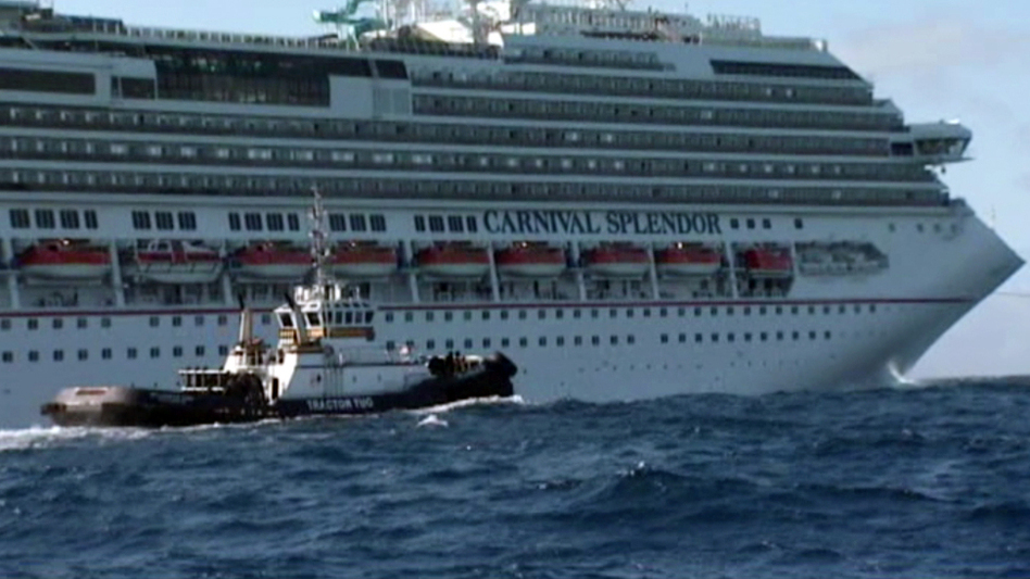 In this image taken from video, tugboats pull the disabled cruise ship Carnival Splendor toward San Diego. (AP)