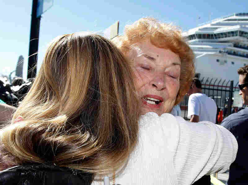 Jeanne Ralston, facing camera, gets a hug from her daughter Cindi Wolfe after disembarking.