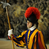 A Swiss Guard stands by a Christmas tree at the Vatican.