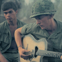 A soldier plays guitar in Vietnam.