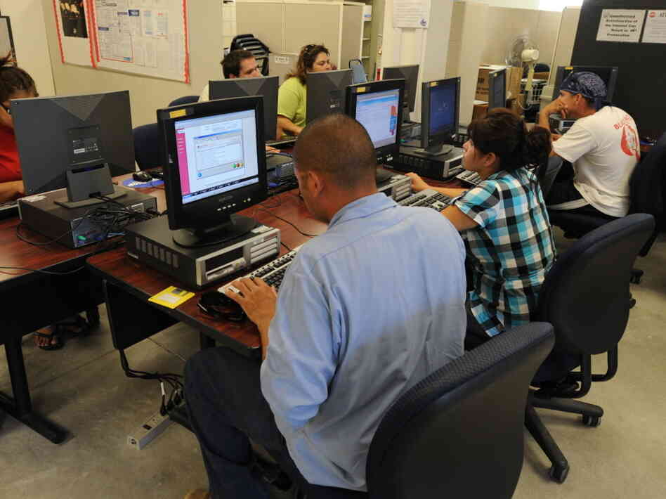 People search for jobs in an employment office in El Cen
