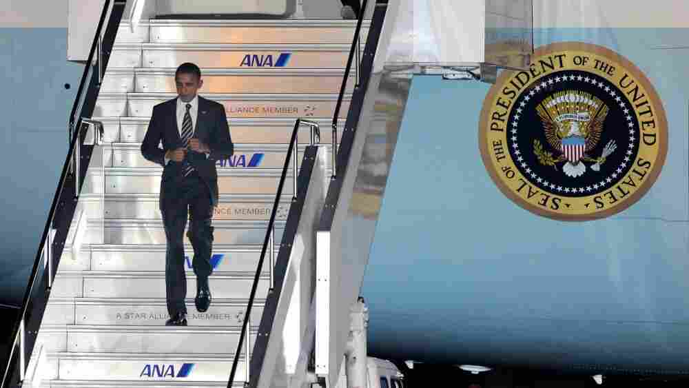 US President Barack Obama disembarks from the Air Force One upon his arrival in Tokyo, ahead of the