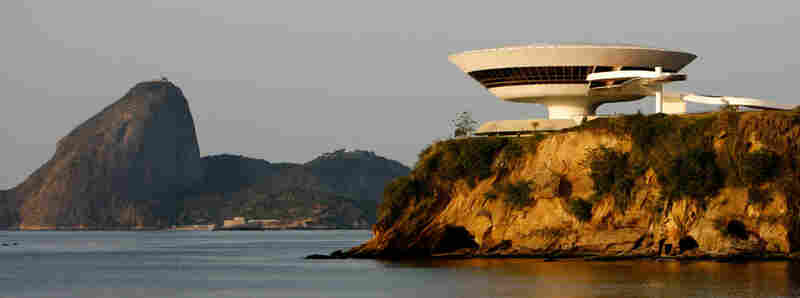 The Niteroi Contemporary Art Museum overlooks the famed landmark Sugar Loaf (left) in Niteroi, Brazil.