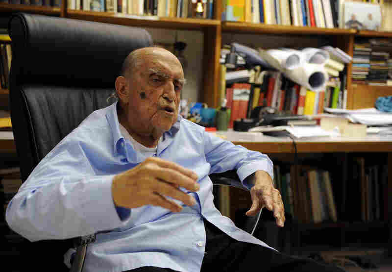 Niemeyer speaks to the press on his 102nd birthday in his studio in Rio de Janeiro, Dec. 15, 2009.
