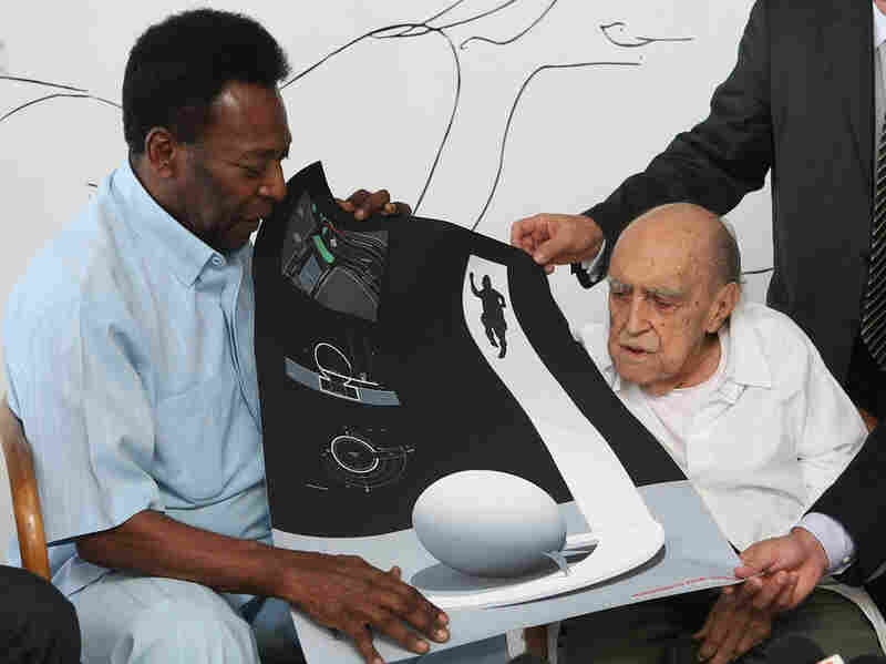 Brazilian football legend Pele and Niemeyer look at the design for the Football Museum of Santos, Nov. 4, 2010, in Rio de Janeiro.