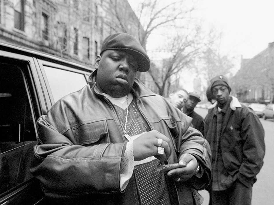 Notorious B.I.G. rolls a cigar outside his mother's house in Brooklyn in 1995.