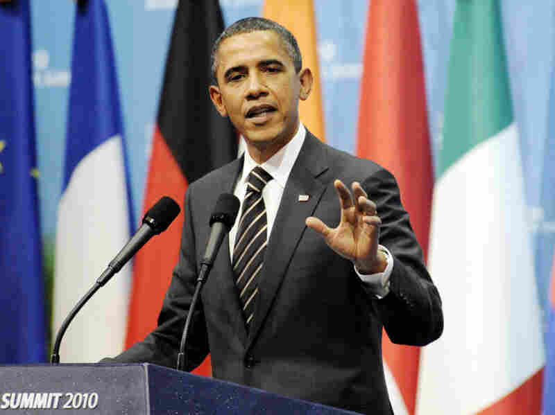 President Obama speaks at a press conference in Seoul after the G-20 summit